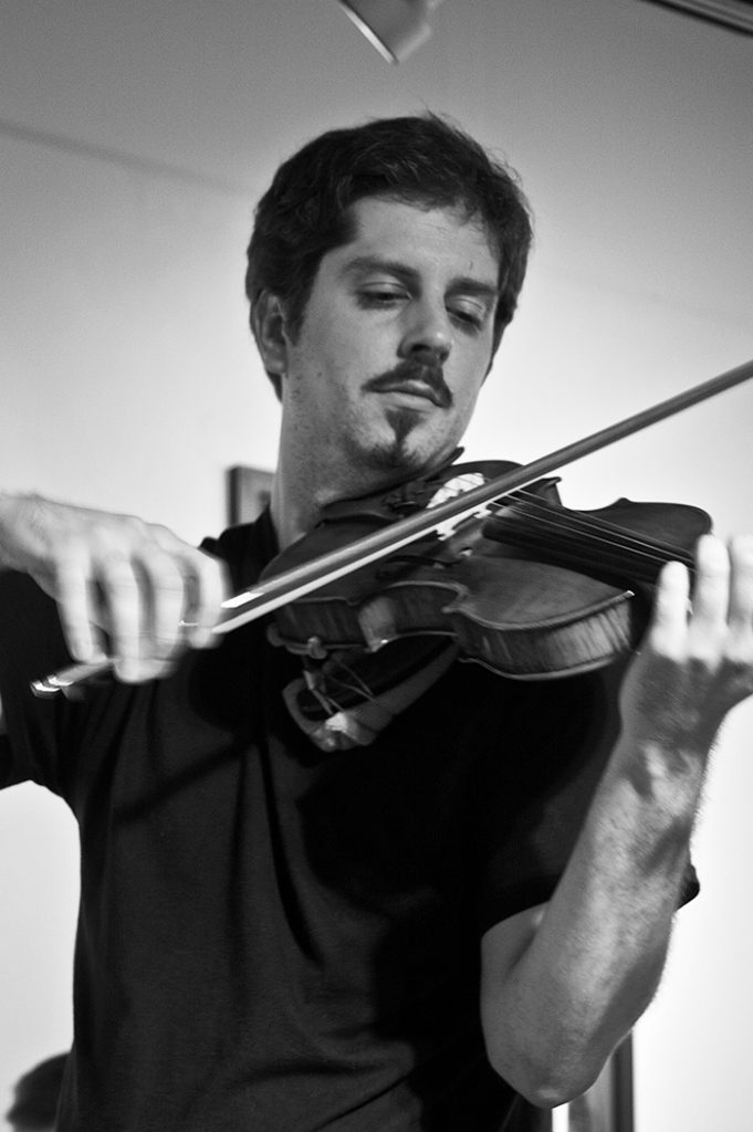 portrait of Maestro Makers violin instructor Allen Russell