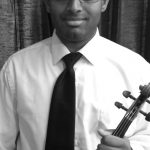 portrait of Maestro Makers violin instructor Neil Gopal